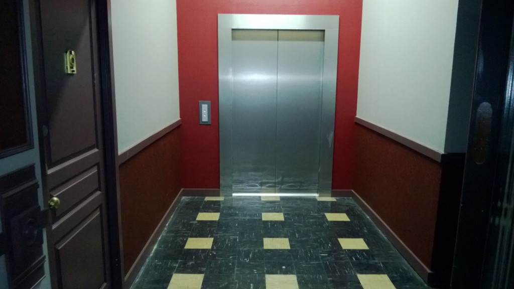 Elevator_Apartment_Hallway_Herald_Examiner